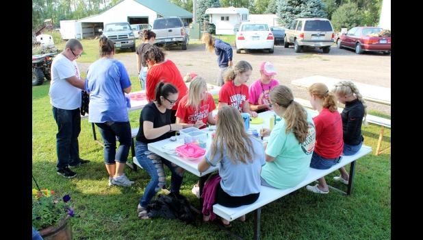 Senior high students gather at the Gacke acreage to paint rocks with messages of love, hope and kindness. The rocks will be placed in the family's memorial garden in honor of Daniella Gacke, 13, who committed suicide June 15.