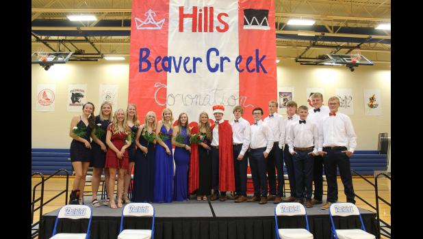 Kenadie Fick and Andrew Harris (center) are this year's Hills-Beaver Creek High School homecoming queen and king. Coronation ceremonies took place Monday night in the school gymnasium. Pictured from left are Emma Deelstra, Taylor Huisman, Grace Anderson, Samantha Moser, Danette Leenderts, Mackenzie Voss, Tara Paulsen, queen Kenadie Fick, King Andrew Harris, Cole Baker, Austin Allen, Oliver Deelstra, Casey Kueter, Blake Leenderts, Cody Moser and Riley Tatge.