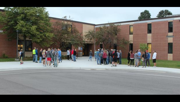 About 50 parents and students gather outside Luverne School District office doors Tuesday morning to peacefully protest school administration's Monday night's mask mandate decision for implementation on Tuesday morning.