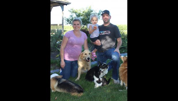 Bethany and Cory Tilstra (holding daughter Emma) started Prairie Wind Pet Cremation in August 2020 as a burial alternative for area pet owners. The family poses with their pets outside at the memorial garden, an option for grieving pet owners to spread their pet's ashes.