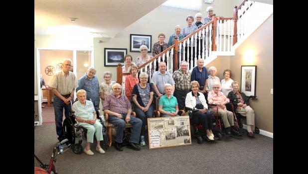 The Oaks residents on hand for an anniversary photograph Thursday include (front, from left) Darlene Boisen, Walter and Jean Baustian, Alvina Hup, Donna Robinson, Ruth Van Westen, Adeline Boelman, (middle row) Jarv Boisen, Mary Ackerman, Marie Klarenbeek, Jean Barclay, John Hup, Al Boeve, Gerard Gust, Florence Helle, Shirley Reisdorfer, (staircase) Shirley Frey, Pat McCormick, Vera Wick, Adele Oien, Margaret Kuiken, Anna Mae Ver Steeg and Goldie Boelman.