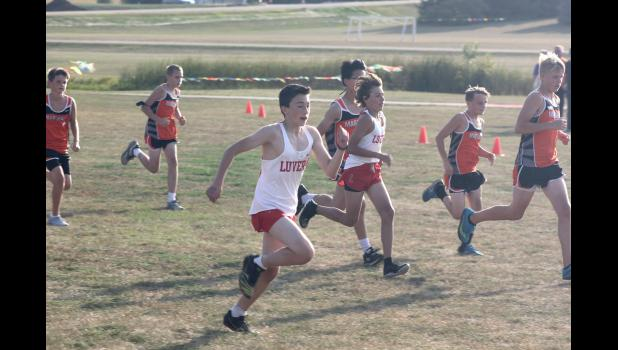 Leif Ingebretson (left) and Levi Gonnerman (right) compete in Luverne's home meet on Friday, Sept. 18.