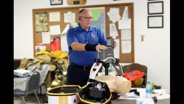 Harlan Vande Kieft with the Rock County Ambulance shows first-responders with the Hardwick Fire Department Sept. 14 how to use the LUCAS chest compression machine. Five of the machines were purchased for first-responder units in Luverne, Magnolia, Hills, Beaver Creek and Hardwick through the CARES Act.