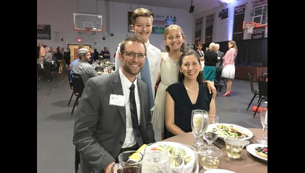John Gulden, a 1996 LHS graduate, was recognized with the President's Award from the St. Francis High School in Louisville, Kentucky. Gulden (left, seated) is pictured with his wife, Noelle, and children Quinn and Else.