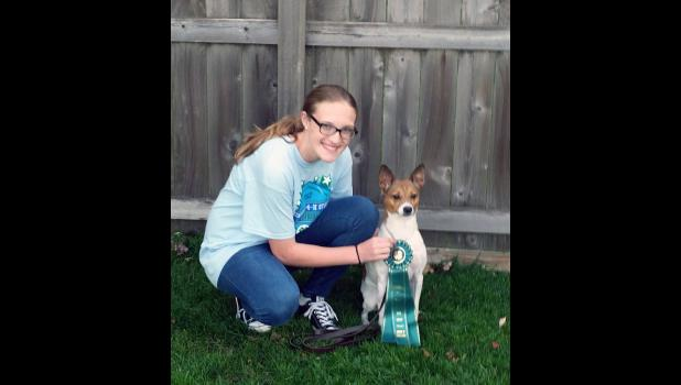Rebecca Austin poses with her dog, Tessa, and the award of excellence the two received at the Minnesota 4-H State Dog Show Sept. 23-24. The lone Rock County entrant in the State Fair also received the Grades 3-8 champion ribbon in Jumpers 1 Agility.