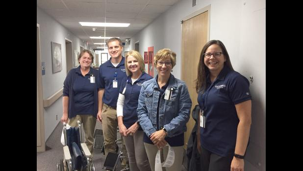 Sanford Luverne physical therapists (from left) Brynn Ladd, Kyle Hailey, Tracy Kramer, Holly Sehr and Jen Hoefert are among a group of therapists who helped with A.C.E. medical equipment Oct. 8. It was part of their community service work to observe Physical Therapy Month in October.