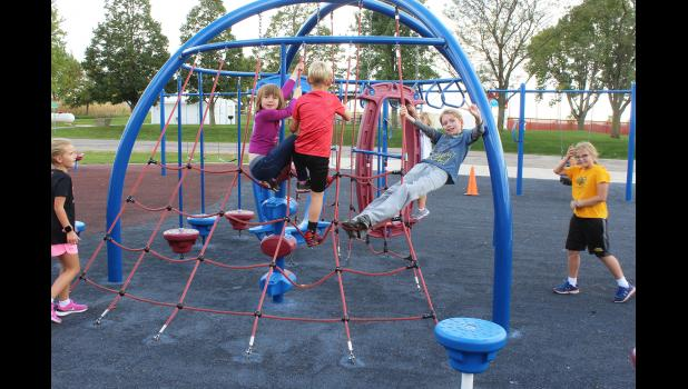 Students enrolled in Hills-Beaver Creek School District's Patriot Enrichment Afterschool Care take advantage of mild fall temperatures on the elementary school playground. Pictured from left are Ellie Metzger, Astrid Aanning, Brooks Metzger, Finley Metzger, Sam Aanning and Nora Tatje.