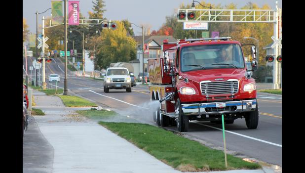 City of Luverne employee and volunteer firefighter Jordan Siebenahler waters the newly planted sod along Highway 75 Monday morning. He estimates using more than 12,000 gallons to complete both sides of the highway.
