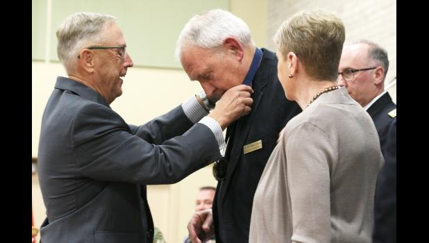 Warren G. Herreid II (center) receives the Court of Honor medal from chairman of the Court of Honor Committee and retired Maj. Gen. Rick Erlandson (left) at an Oct. 6 ceremony at Camp Ripley. Herreid's wife, Jeannine Rivet, watches.