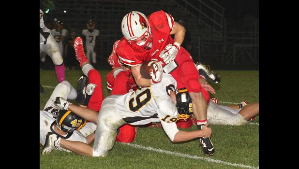 Luverne senior running back Erik Tofteland absorbs a hit from Sibley East's Seth Fredin during a Section 3AAA playoff game at Cardinal Field Oct. 14. LHS fell 33-19 to end the season.
