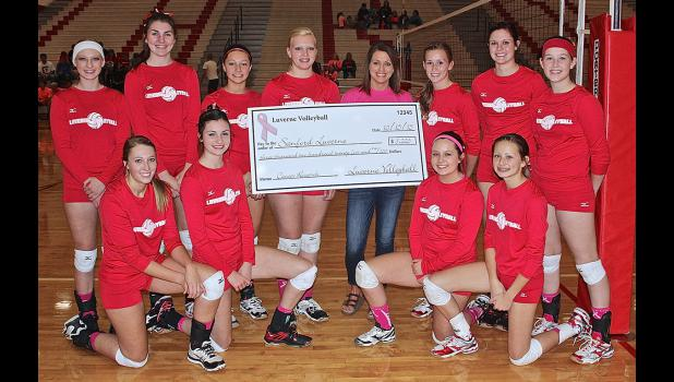 The Luverne volleyball team raised $3,225 for breast cancer awareness during a Dig Pink Donation War prior to a match against Pipestone Oct. 8. The Cardinals donated the money to Luverne Sanford Hospital representative Crystal Serie (back, fourth right) prior to Thursday's match against Redwood Valley. Pictured from the LHS squad are (kneeling, from left) Hanna Honermann, Madison Crabtree, Sydney Maciej, Hannah VerSteeg, (back) Katie Kracht, Alexis Ferrell, Hailey Franken, Nicole Kneip, Sierra Schmuck, Hail