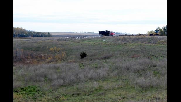 A truck arrives at the Rock County Transfer Station's construction and demolition landfill Thursday, Oct. 20, with a load of debris. The county may request a change in the current slope for burial that could add five additional years to the landfill's life expectancy.
