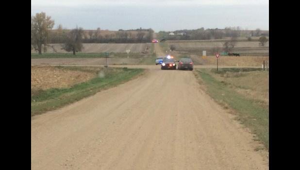 Minnesota State Patrol squad cars wait at at the South Dakota state Line Tuesday morning. Peter Bakken shared this image, which was captured near his home west of Highway 23 facing west. The acreage where the suspect was detained is pictured in the next mile to the right.