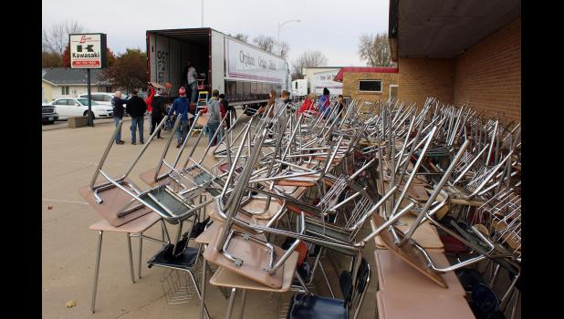Surplus Luverne School District desks were loaded onto semitrailers Saturday morning by students and adult volunteers with the local youth group Rock the Edge and driven by Orphan Grain Train volunteers to communities who could use the desks.