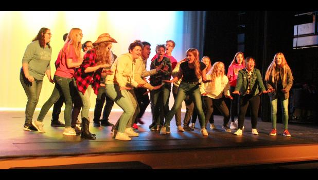 """Luverne High School students sing the opening number, """"Footloose."""""""