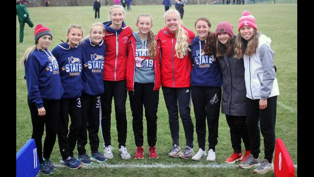 Members of the Luverne girls' cross country team pose for a photo before making school history at the state meet in Northfield Saturday. Team members include (from left) Grace Ingebretson, Kayla Bloemendaal, Jenna DeBates, Elizabeth Wagner, Brooklynn Ver Steeg, Regan Feit, Tenley Nelson, Makena Nelson and Tiana Lais.