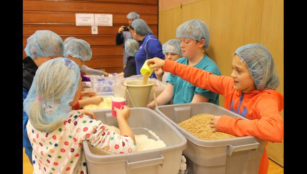 Students pack ingredients during the 2015 event in Luverne.