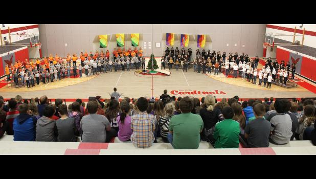"""More than 170 second- and fourth-graders sing """"It's Snowing Cats and Dogs"""" in the Luverne Elementary School gym Friday as part of their performance of Teresa Jennings' """"Unity Tree,"""" directed by music teachers Morgan Smith and Beth Capistran."""