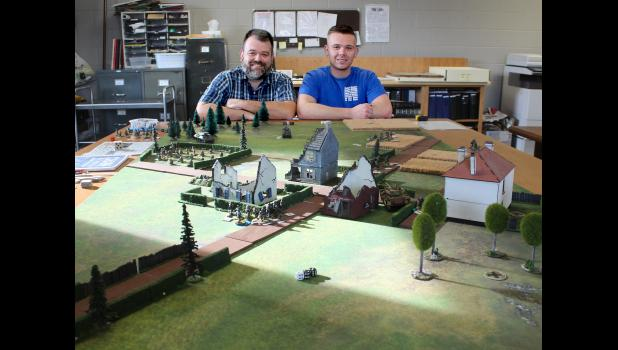 Mike Westerbur and his son, Dylan, 22, shared their passion for miniature war games at the History Center in Luverne Monday. On Saturday a group of fellow miniature wargamers from Sioux Falls joined for a battle demonstration.
