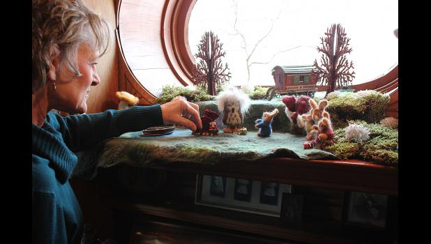 "Carol Ceynowa's ""Christmas in the Forest"" is set up in the window of the Hinkly House library."
