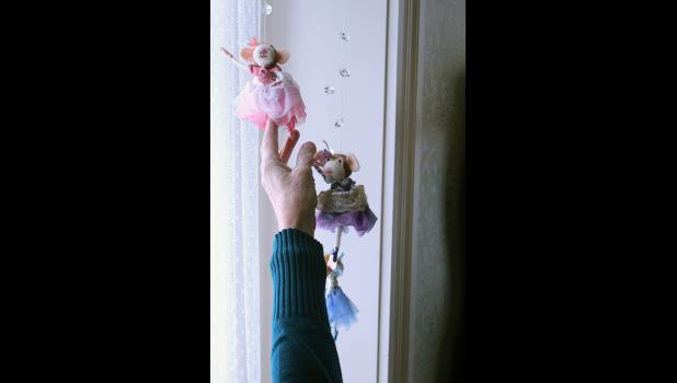 Ballerina mice dance in the sitting room window.