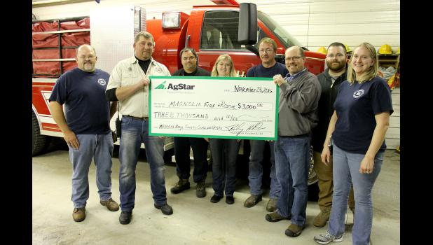 The Magnolia Fire and Rescue Department recently received $3,000 from the AgStar Financial Services Fund for Rural America from local representative Pat Barnett. Pictured are (front, from left) Magnolia Mayor Dennis Madison, Scott Dohlmann, Barnett, Jean DeGroot, (back) Robert Somnis, Stacie Dohlmann, Steve DeGroot and Tom Strassburg.