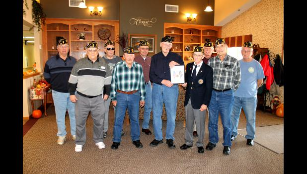 Members of Hardwick's Arthur Moeller American Legion Post visit Poplar Creek Estates Monday, Nov. 23, where they presented Bill Holling with a 59-year membership award. Making the presentation were (front, from left) Bill DeBates, Larry Tweet, Holling, Wayne Holmgren, Lowell Ahrendt, (back) Wes Pierson, Bruce Wilson, Paul Aukes, Don Bryan and Gary Holmgren.