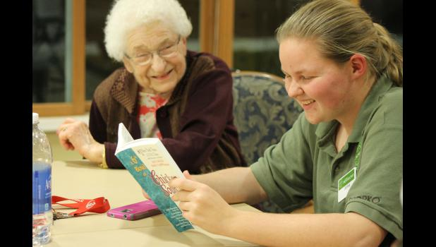 Mary Jane Brown Home resident Dorothy Williamson (left) shares a laugh with Jenna Schelhaas during one of Schelhaas' Sunday night Senior Book Club sessions in Luverne.