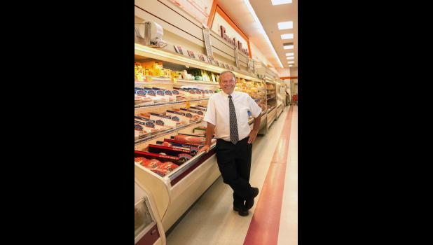 Glen Gust announced his retirement Friday, when he signed the purchase agreements for his grocery and convenience stores to Teal Family, who operate 11 area grocery stores under the names Teals Market and Fiesta Foods.