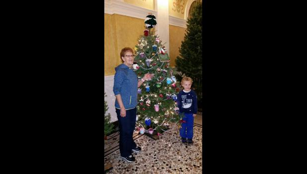 Lorraine Stoel, Luverne, was selected to decorate one of 100 Christmas trees on display in the Capitol rotunda in Pierre, South Dakota. She's pictured with Noah Tainowitz, a third generation nephew.