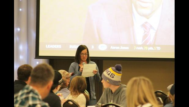 Megan Boyenga reads a prepared thank you Sunday during halftime of the Vikings-Lions football game, which was shown during the fundraising dinner and online auction for her and her children to stay on the family farm.
