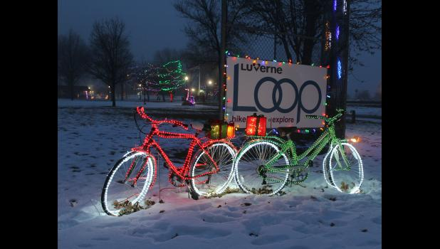 """Luverne Loop was voted the favorite """"Love the Light"""" display at the city park Sunday night, where 80 carloads drove the circular route looking at the 24 displays set up by businesses and organizations."""