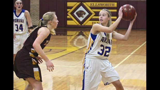 Adrian's McKinley Nelson keeps the ball out of the reach of Ellsworth's Kallie Chapa during Thursday's girls' basketball game in Ellsworth.