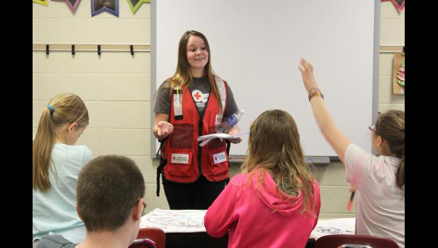 After the large group presentation, American Red Cross Disaster Program Specialist Morgan Sommers answers questions Friday about emergency preparedness by visiting each of the fifth-grade classrooms at Luverne Elementary.