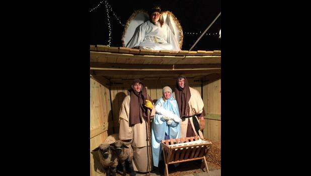 In the manger scene are Samantha Wieneke (angel), Erik Tofteland, Madi Oye and Dylan Thorson.