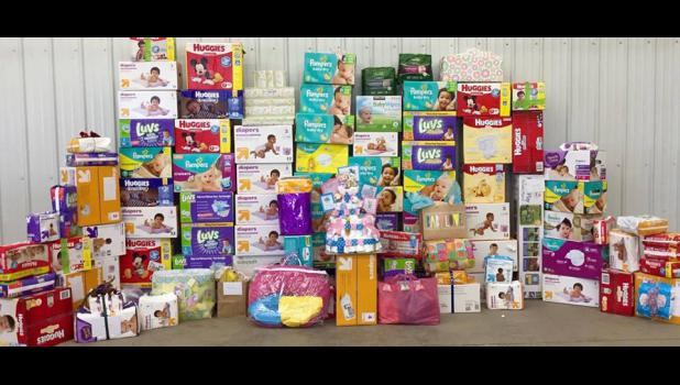 A recent celebration party for the Boyenga family's triplets yielded more than 90 packages and boxes of diapers.