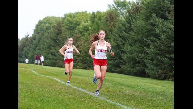 LHS runners Tenley Nelson and Jenna DeBates finish first and second respectively in the varsity girls' 5K race Saturday during the Bruce Gluf Classic meet in Luverne. The LHS girls' team finished first.