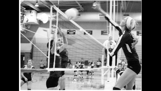 Hannah Beam (shown above, at right) sends a kill attempt over the net in a league match on Tuesday night. After smooth sailing early, Beam and the teanm adjusted in the midst of some adversity and stayed on track to get the sweep.