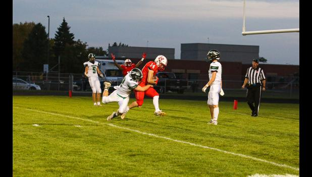 Zach Kruse connects with a pass from Casey Sehr in the end zone to complete a two-point conversion to give the Luverne Cardinals an 8-0 lead in the first quarter of the Battle Axe game with Pipestone, which won 20-16.