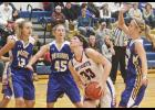 H-BC senior Grace Bundesen works inside the paint between AHS defenders Marissa Lehnhoff, Shawna Rogers and McKinley Nelson during Friday's game in Adrian.