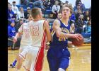 Adrian senior Ryan Wieneke drives to the basket as Fulda's Matthias Kunerth impedes is path during Friday's game in Adrian.