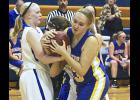 Adrian's Paige Bullerman fights for one of her 10 rebounds during Monday's 46-42 home win over Windom.