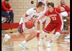 Luverne senior Carter Stemper pressures W-WG's Andrew Quade during Saturday's game in Luverne.