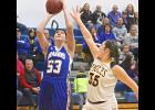 Adrian senior post Paige Bullerman puts up a shot in front of SWC's Hannah Nerem during Thursday's basketball game in Adrian.