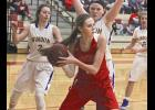 Luverne senior post Rachel Oftedahl protects the ball after grabbing a rebound during Friday's 66-46 home win over Windom.