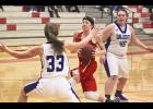 Luverne sophomore Mallory Thorson drives to the basket in front of HL-O defender Taylor Johanning during Thursday's game in Luverne. Thorson netted a team-high 18 points during an 86-31 win.