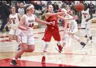 Brooklynn Ver Steeg delivers a pass to a teammate during Thursday's 48-40 home win over Worthington.