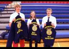 Hills-Beaver Creek High School FFA'ers (from left) Joshua Wiersema, Sophia VanSurksum and Collin Schoneman display the free corduroy jackets they earned through a future leaders application sponsored by the Minnesota FFA Foundation.