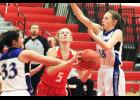 Luverne freshman Elizabeth Wagner draws contact as she drives to the basket during Monday's home game against MCW.