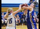 Adrian senior Lexi Slater draws a foul from HL-O's Abi Fest as she attempts to put up a shot in the paint during Tuesday's game in Adrian.
